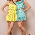 Two beautiful women in summer dresses. — Stock Photo