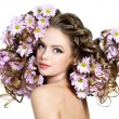 Flowers in long hair of woman — Stock Photo