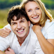 Happy smiling couple on nature — Stock Photo