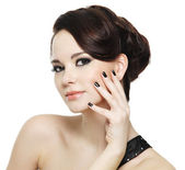 Woman with black nails and bright eye make-up — Stock Photo