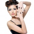 Woman with stylish hairstyle and black nails — Stock Photo #9001268
