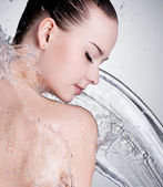 Portrait of beautiful woman with water — Stock Photo