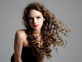 Glamour woman with curly hair — Stok fotoğraf