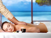Relaxing woman having spa massage — Stock Photo