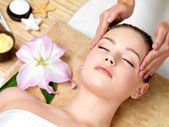 Woman having spa massage of the head — Stock Photo