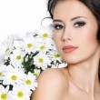 Royalty-Free Stock Photo: Portrait of sexy woman with white flowers