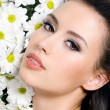 Sexy female face with flowers - Stock Photo