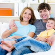 Happy family with son on the sofa — Foto Stock