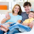 Happy family with son on the sofa — Stockfoto #9107905