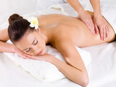 Massage for the back of woman in spa salon — Stock Photo