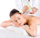 Heathy massage for young woman with aromatic oils — Stock Photo