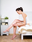 Woman caring of her beautiful legs — Stock Photo