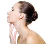 Beautiful woman pampering the neck — Stock Photo