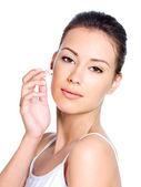 Woman applying moisturizer facial cream — Stock Photo