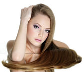 Portrait of beautiful girl with long straight hair — Stock Photo