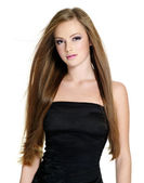 Beautiful woman with long straight hair — Stock Photo