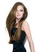 Beautiful teen girl with long straight hair — Stock Photo