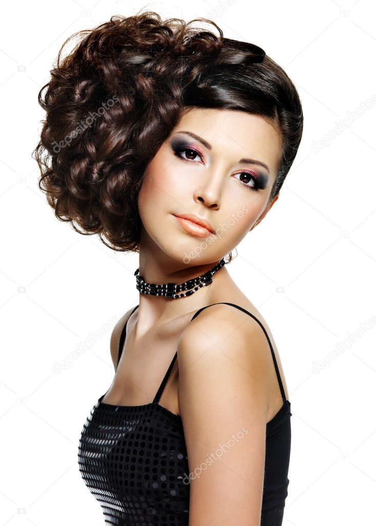 Beautiful young woman with fashion hairstyle and glamour makeup - on white background — Stock Photo #9528158
