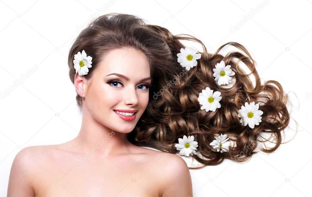 Smiling healthy woman with beautiful long hair  - white background  Stock Photo #9528182