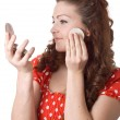 Girl putting facial powder on her face — Foto Stock
