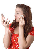 Girl putting facial powder on her face — Stock Photo