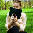 Girl in the park with a book — Stock Photo