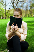Girl in the park with a book — Стоковое фото
