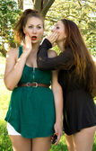 Two girls who fissile secrets with each other — Stock Photo
