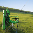 Stock Photo: Chair fishermand fishing rod.