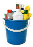 Detergent bottles, brushes, gloves and sponges in bucket — Stock Photo