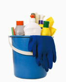 Plastic bucket with cleaning supplies on white background — Stock Photo