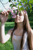 Woman enjoying spring full-blown tree — Stock Photo
