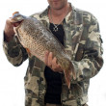 Fisherman with big fish Carp. Success concept. — Stock Photo #10544660