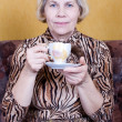 Adult woman resting with a cup of tea — Stock Photo