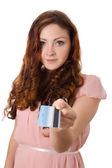 Girl with a bank credit card — Stock Photo