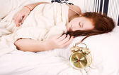 The girl sleeps on bed-clothes. — Stock Photo