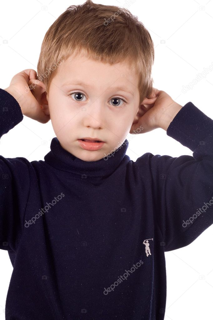 Cheerful kid grimaces, pulls his ears  Stock Photo #8464732