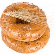Bagels with wheat ears — Stock Photo