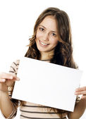 Teenager holding a piece og paper — Stock Photo