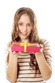 Girl with a gift in the hands of — Stock Photo