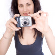 Woman with a camera takes — Stock Photo