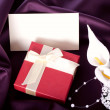 Foto Stock: Holiday gift with bouquet and postcard