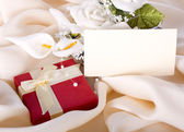 Holiday gift with a bouquet of the bride — Stock Photo