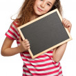 Girl with blackboard — Stock Photo