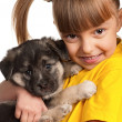 Girl with puppy - Stockfoto