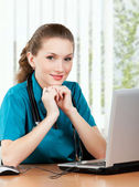 Doctor with laptop — Stock Photo