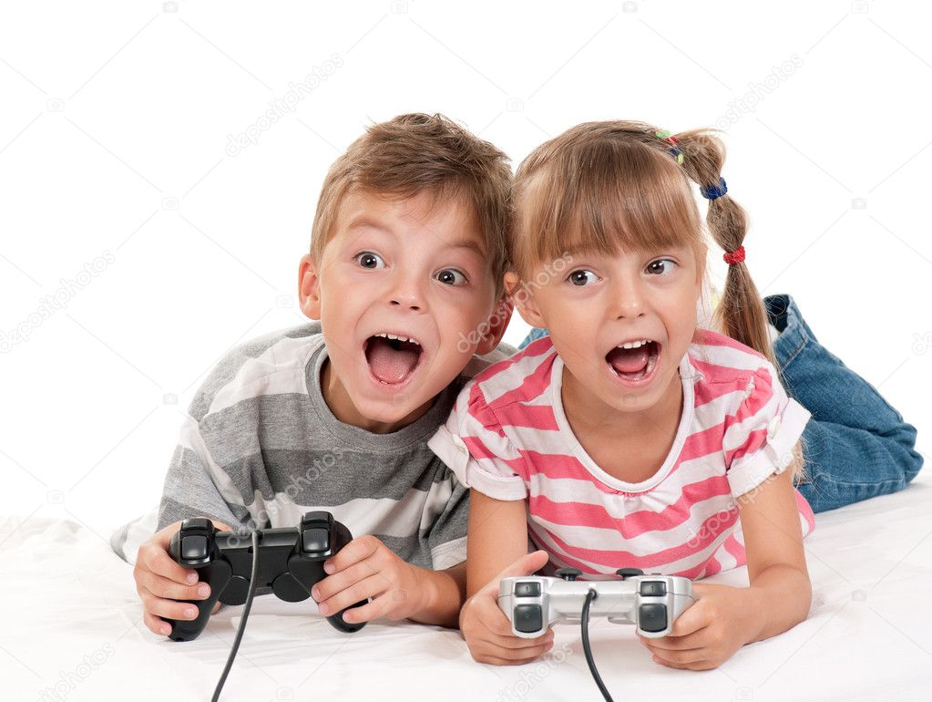 Happy children - girl and boy playing a video game — Stock Photo #10464563