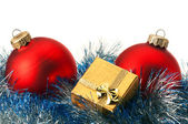 Christmas baubles and gift box — Stock Photo