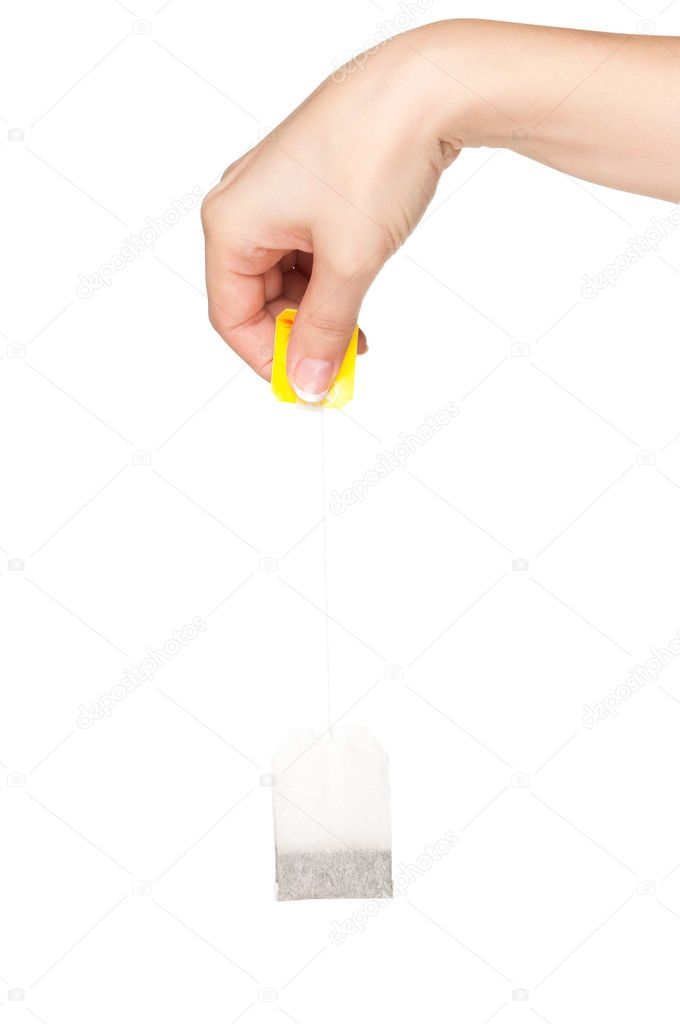 Woman hand with teabag isolated on white background — Stock Photo #8617922