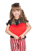 Little girl with red heart — Stock Photo